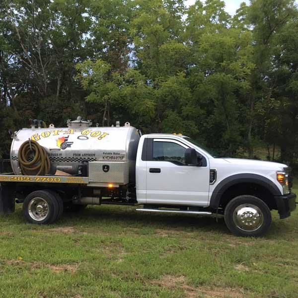 White septic pumping truck